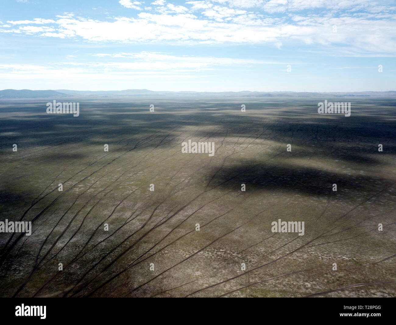 Empty Lake George nestled between a rural wind farm and farmland in Australia. Lake George is an endorheic lake, as it has no outflow of water to rive Stock Photo