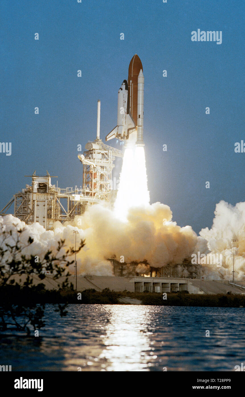 (11 Nov. 1982) --- Having completed its four-mission test program, the space shuttle Columbia begins a new era of operational flights as it clears the launch tower and heads for Earth orbit. - Stock Image