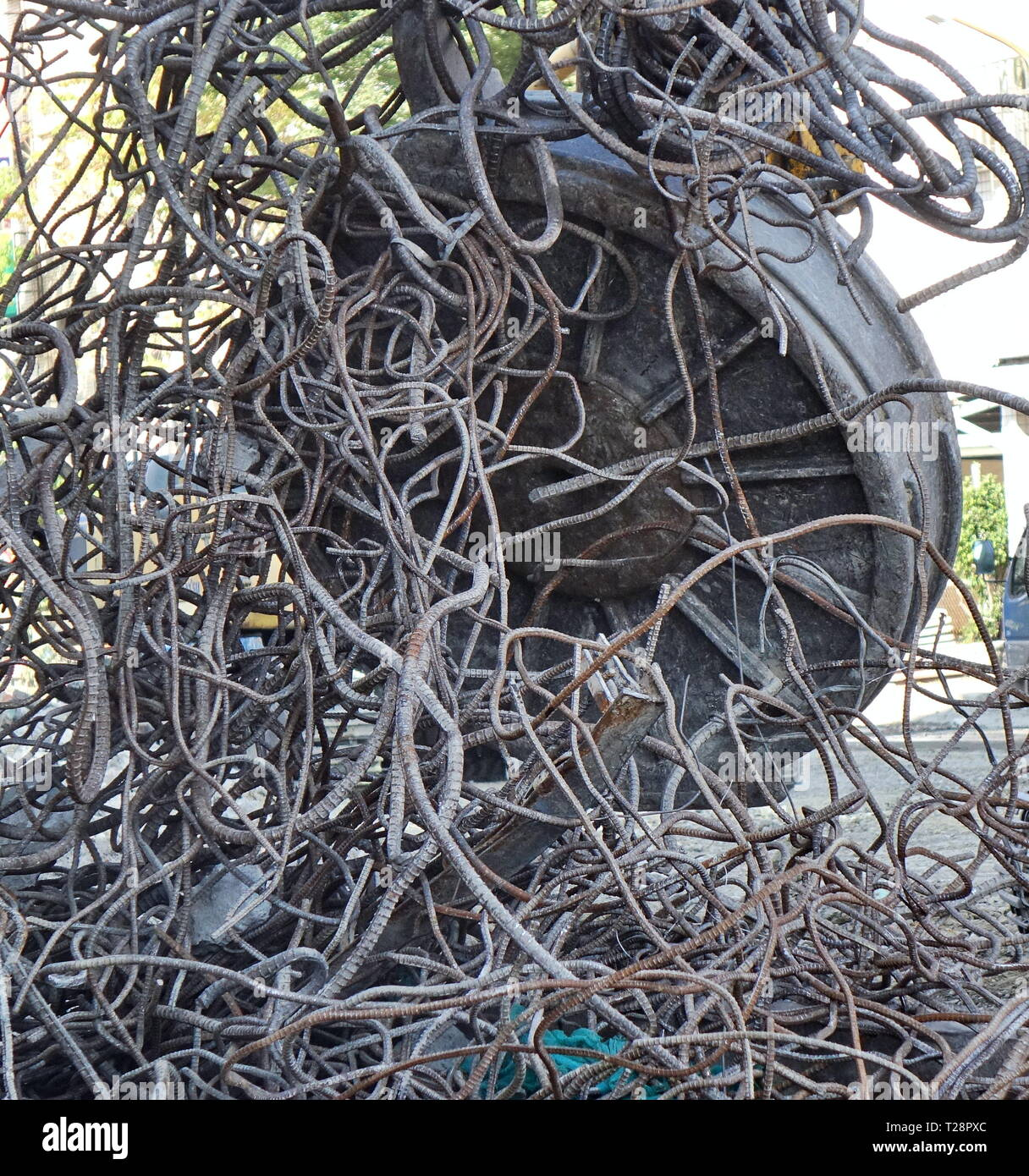A powerful industrial magnet picks up scrap metal from a demolition project - Stock Image