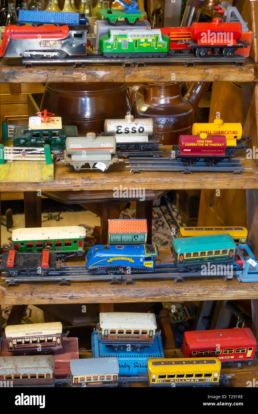 Interior of Eskdale Antiques a rural antique shop showing a collection of O gauge model railway tinplate rolling stock - Stock Image