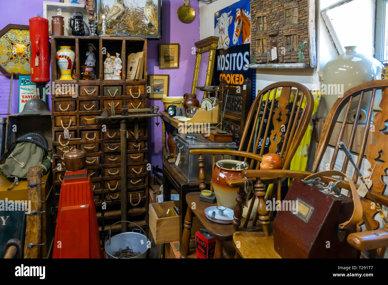 Interior of Eskdale Antiques a rural antique shop with a collection of old country farm and kitchenware - Stock Image
