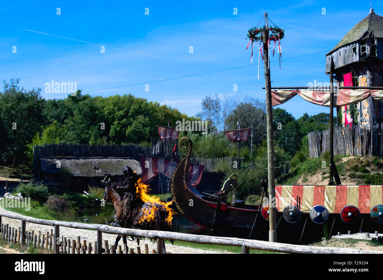 Les Epesses, France - September‎ ‎8‎, ‎2018 : Vikings show from Puy du fou where a stunt man is riding a horse set on fire Stock Photo