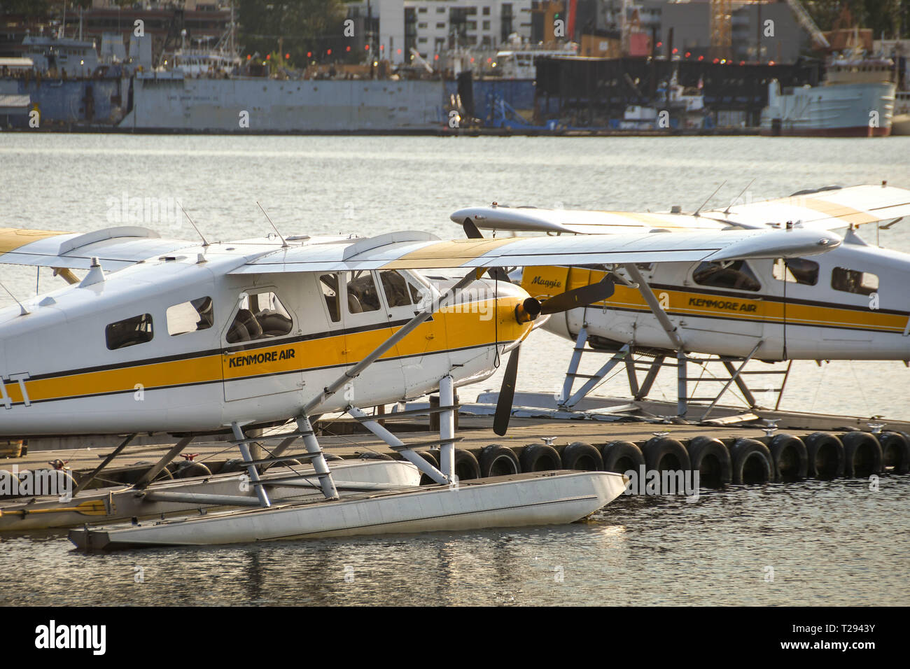 SEATTLE WA, USA - JUNE 2018: Floatplanes operated by Kenmore Air at the jetty of the seaplane terminal in Seattle at dawn. Stock Photo