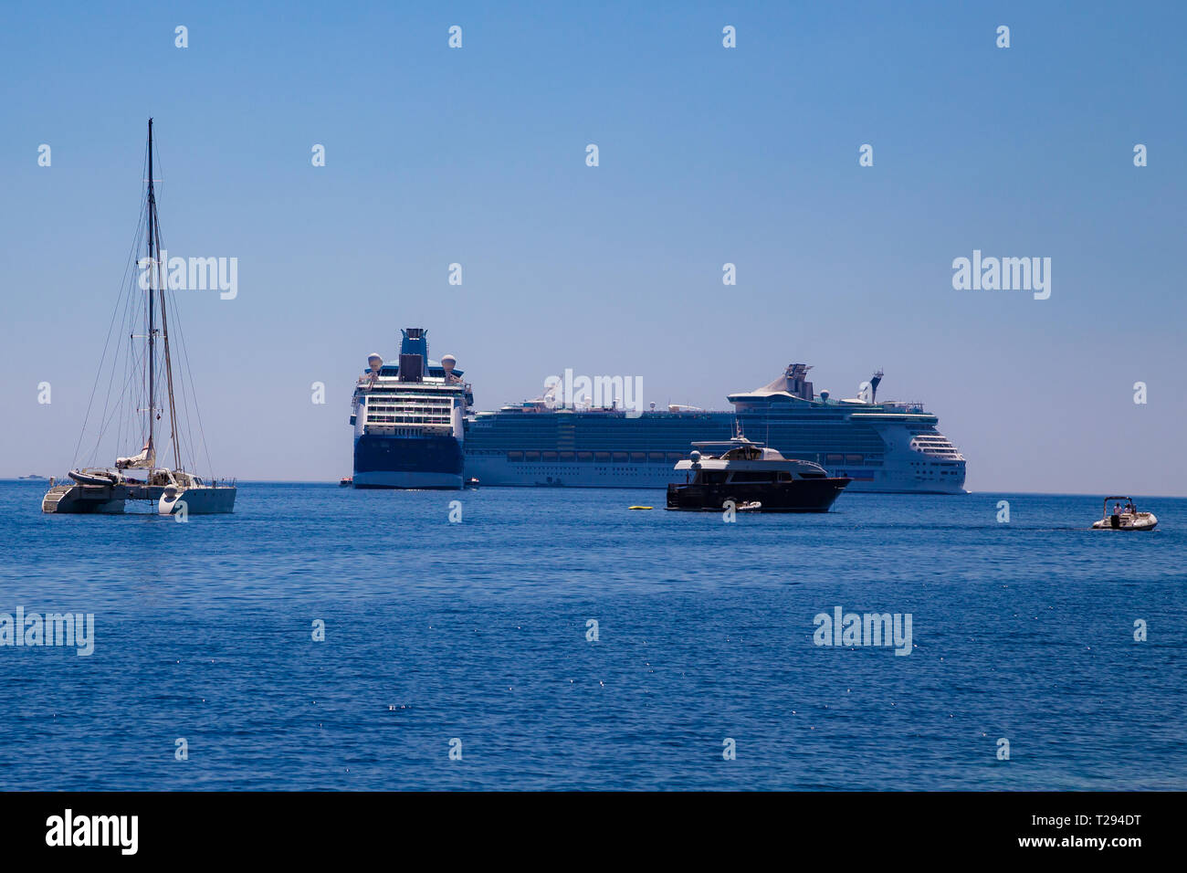 Two cruise ships and a twin hulled boat in the sea, Villefranche, France - Stock Image