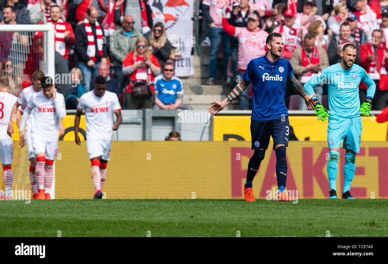 Cologne, Germany. 31st Mar, 2019.  Soccer: 2nd Bundesliga, 1st FC Cologne - Holstein Kiel, 27th matchday in the Rhein-Energie-Stadion. Kiel's goalkeeper Kenneth Kronholm (r-l) and Kiel's Dominik Schmidt are on the field after the goal to 2-0. Photo: Guido Kirchner/dpa - IMPORTANT NOTE: In accordance with the requirements of the DFL Deutsche Fußball Liga or the DFB Deutscher Fußball-Bund, it is prohibited to use or have used photographs taken in the stadium and/or the match in the form of sequence images and/or video-like photo sequences. Credit: dpa picture alliance/Alamy Live News Stock Photo