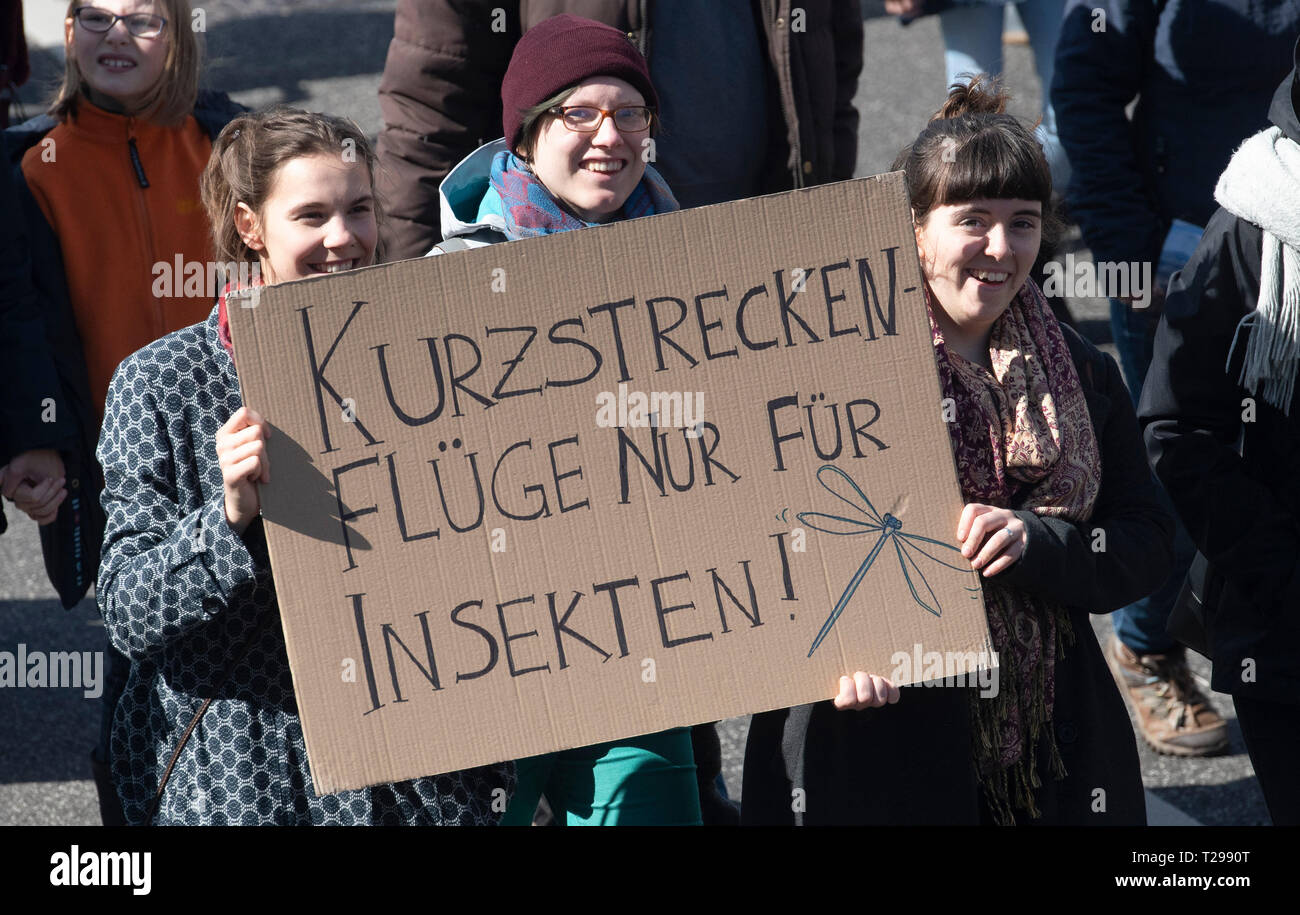 Potsdam, Germany. 31st Mar, 2019. Participants in the demonstration of the alliance 'Potsdam For Future' hold a poster: 'Short-haul flights only for insects'. Called to the demonstration have different groups. Credit: Paul Zinken/dpa/Alamy Live News - Stock Image