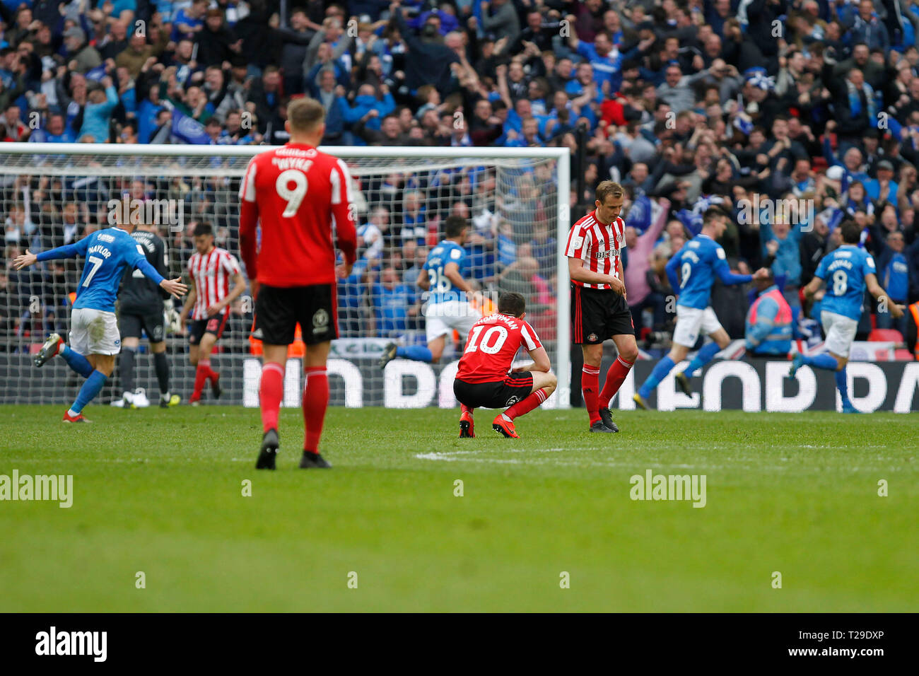 Sunderland AFC players are dejected after Portsmouth  take the lead during the Checkatrade Trophy Final match between Portsmouth and Sunderland at Wembley Stadium, London, England on 31 March 2019. Photo by Carlton Myrie.  Editorial use only, license required for commercial use. No use in betting, games or a single club/league/player publications. - Stock Image