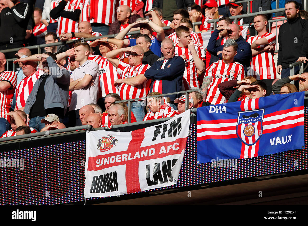 Sunderland AFC fans shield their eyes to watch the match during the Checkatrade Trophy Final match between Portsmouth and Sunderland at Wembley Stadium, London, England on 31 March 2019. Photo by Carlton Myrie.  Editorial use only, license required for commercial use. No use in betting, games or a single club/league/player publications. - Stock Image