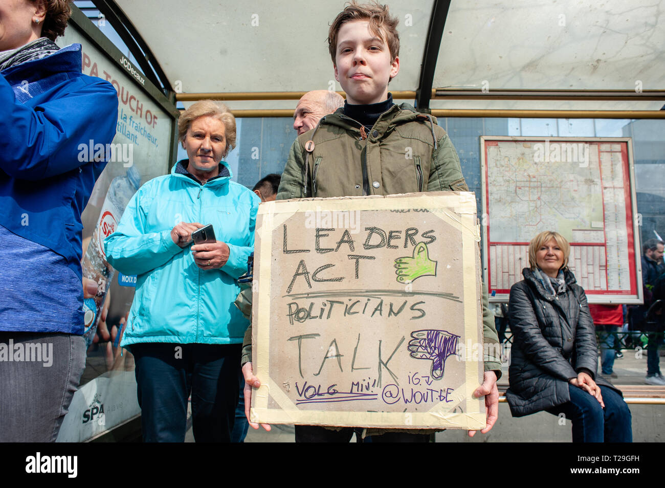 A boy is seen holding a placard during the demonstration. Thousands of people gathered as always at the Brussels North station to demand a declaration of a state of environmental emergency and a climate law to reduce C02 emissions by 55% by 2030, the climate as a top priority, the adoption of the Finance-Climate Pact, the respect of the Paris agreements and the protection of water and forests. - Stock Image
