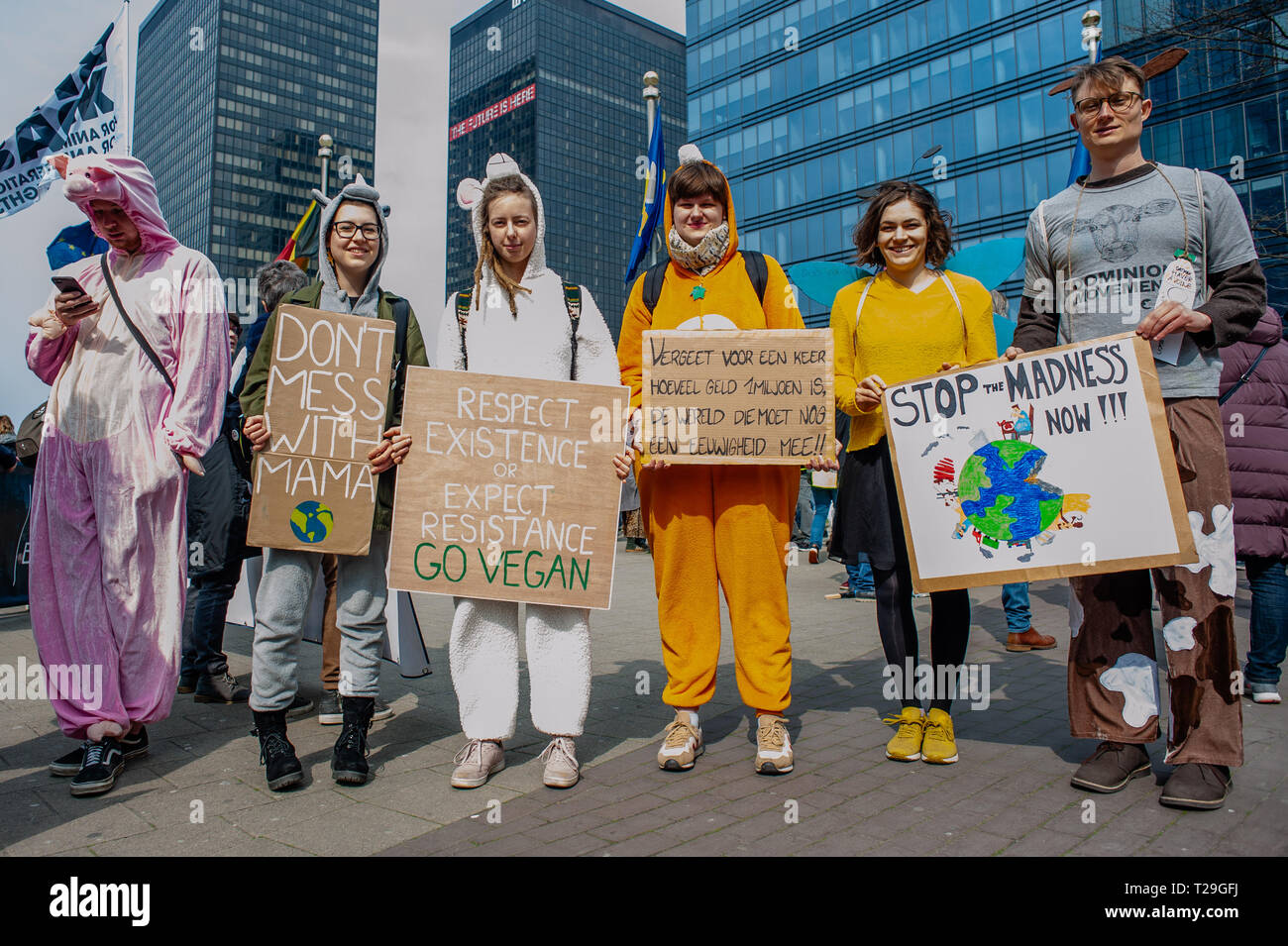 A group of people are seen dressed like animals and holding placards during the demonstration. Thousands of people gathered as always at the Brussels North station to demand a declaration of a state of environmental emergency and a climate law to reduce C02 emissions by 55% by 2030, the climate as a top priority, the adoption of the Finance-Climate Pact, the respect of the Paris agreements and the protection of water and forests. - Stock Image