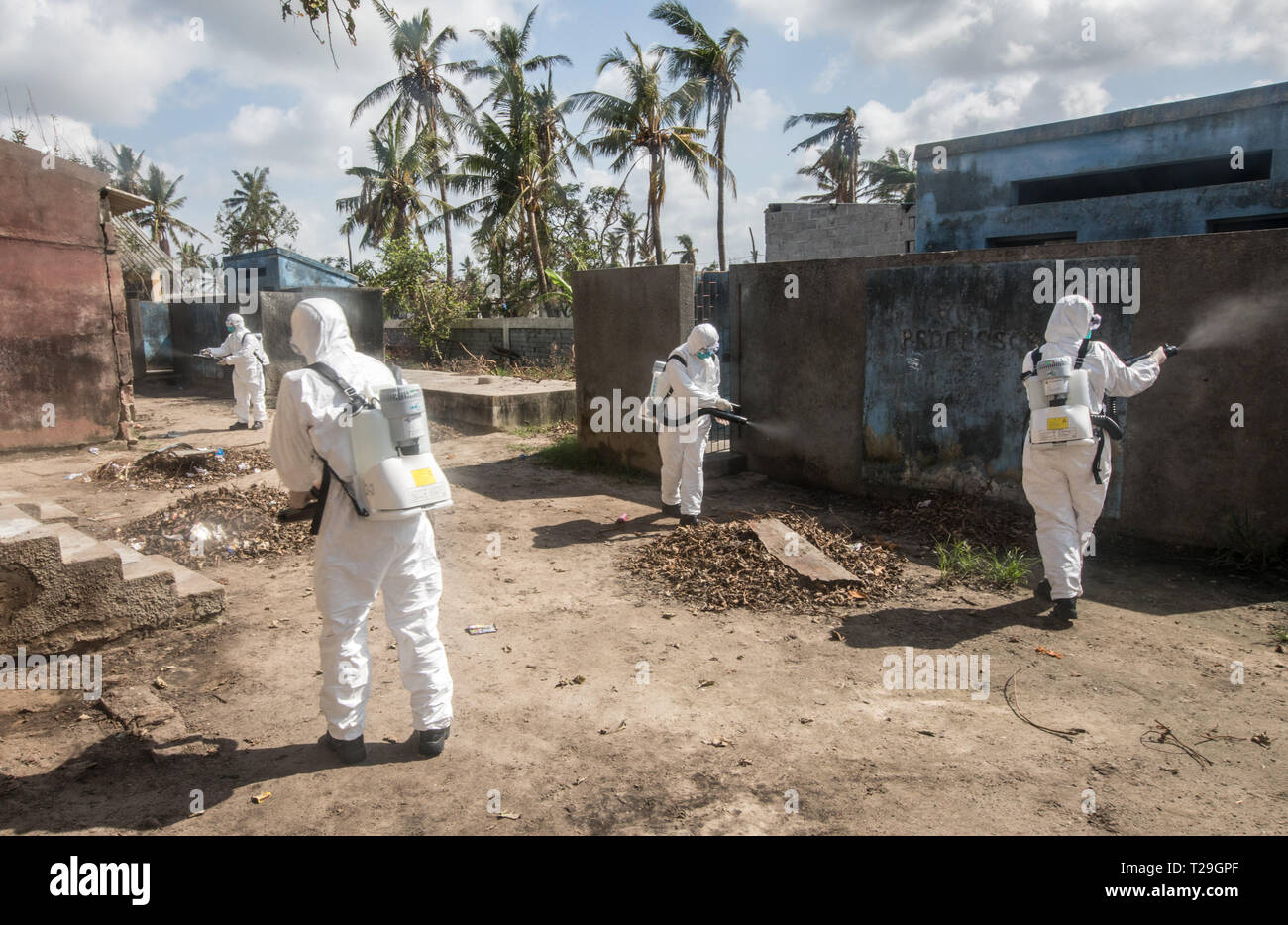 Beira, Mozambique. 29th Mar, 2019. Members of the Chinese rescue team spray disinfectants at Amilcar Cabral Elementary School, a temporary shelter for victims of the Cyclone Idai, in Beira, Mozambique, March 29, 2019. TO GO WITH 'Feature: Chinese rescuers join Mozambicans to prevent epidemics following Idai disaster' Credit: Zhang Yu/Xinhua/Alamy Live News - Stock Image