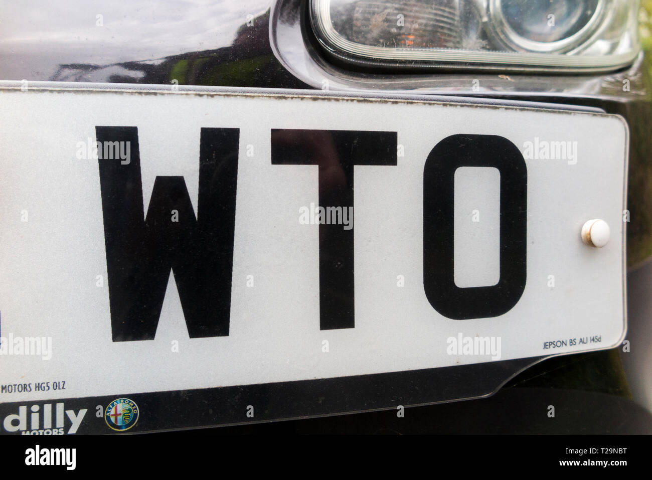 Car number registration plate which includes the letters WTO which could stand for world trade organisation. (106) Stock Photo