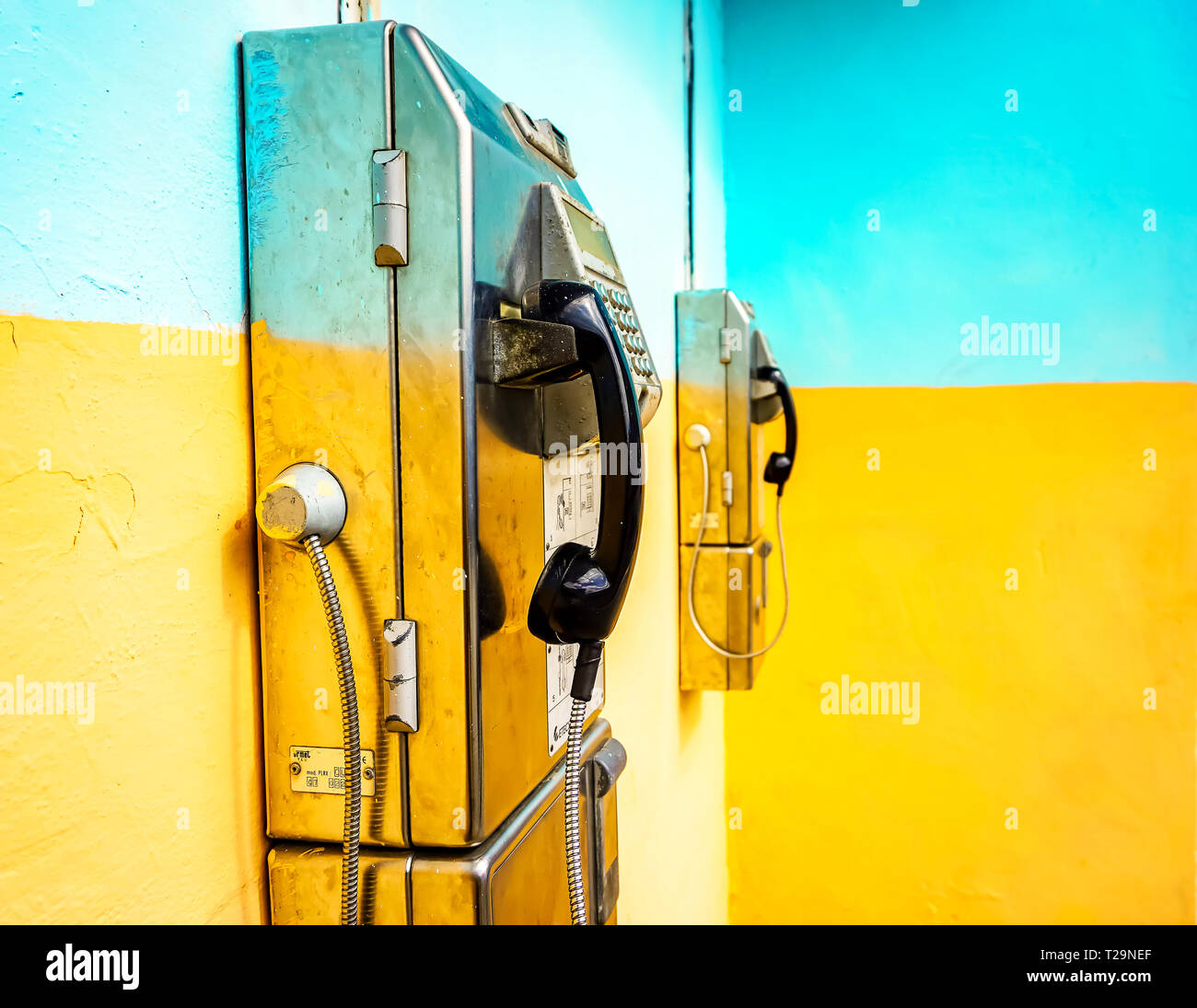 Cuba and the people. You can see in this picture how the mindset is. They painting over the telephone box. You can see the spots on the phone box. - Stock Image