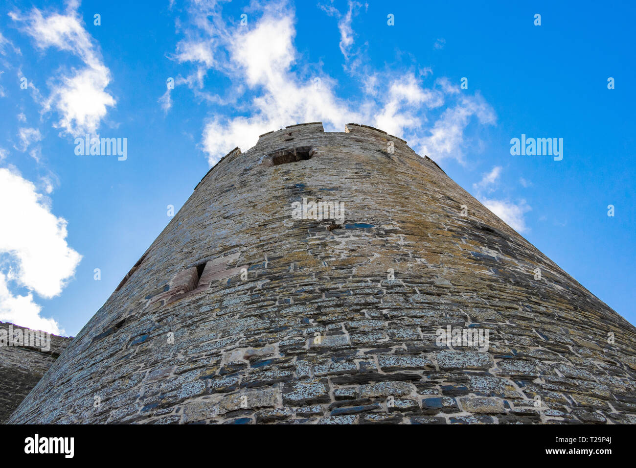 perspective view looking up a stone tower of Conwy Castle North wales - Stock Image