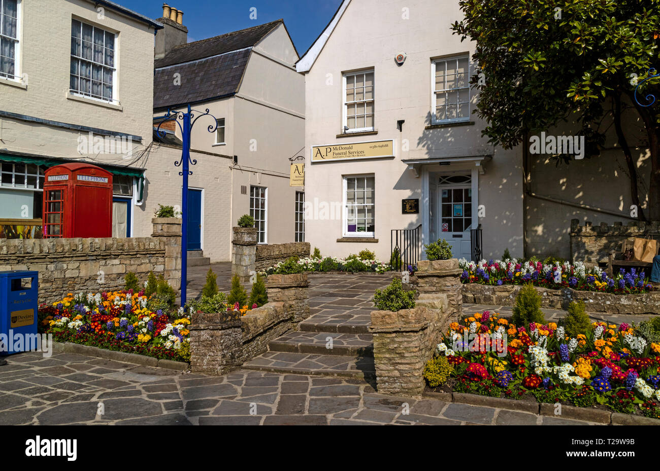 Devizes, Wiltshire, England, UK. March 2019. Funeral parlour with spring flowers the town centre. - Stock Image