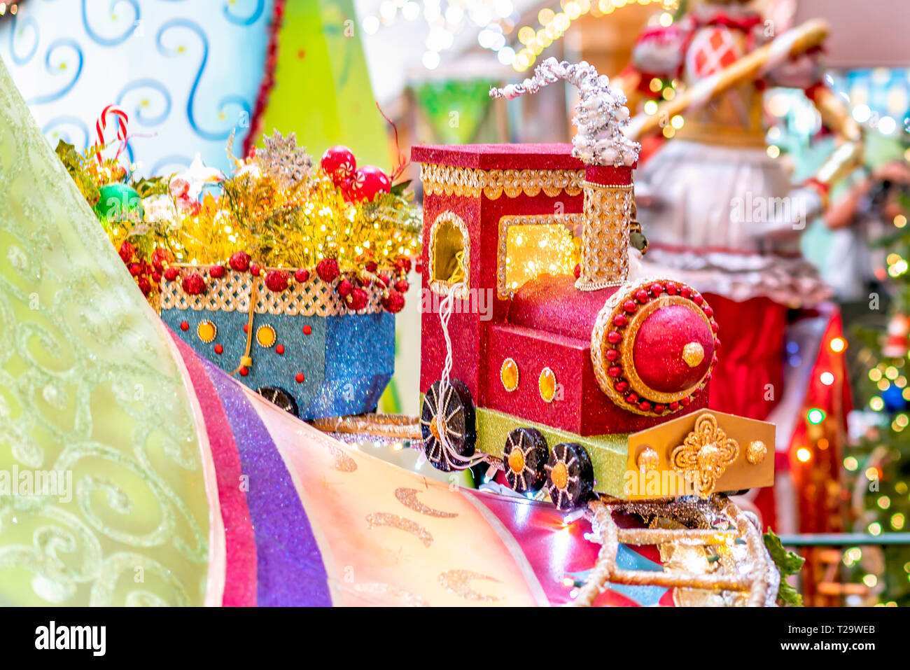 Colorful Christmas train decoration with lights and a sparkle background - Stock Image
