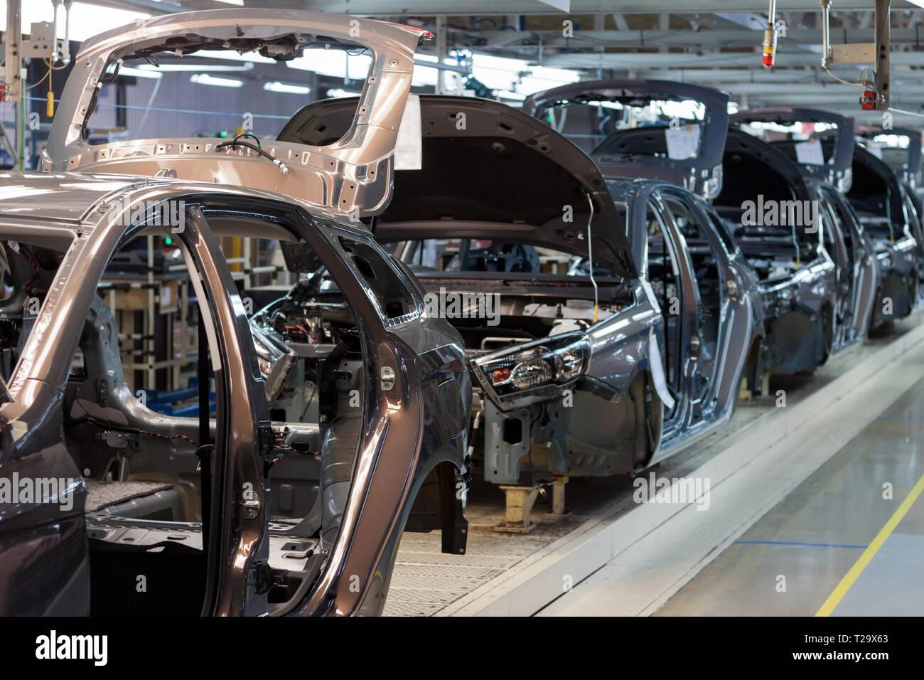 Russia, Izhevsk - December 15, 2018: LADA Automobile Plant Izhevsk, part of the AVTOVAZ Group. Frame construction of a new car on the conveyor line. A - Stock Image