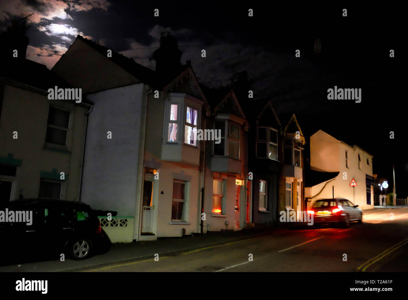 terraced,house,houses,at,night,moon,rise,clouds,night,bed,time,bedroom,story,lights,security,light,England,UK, - Stock Image