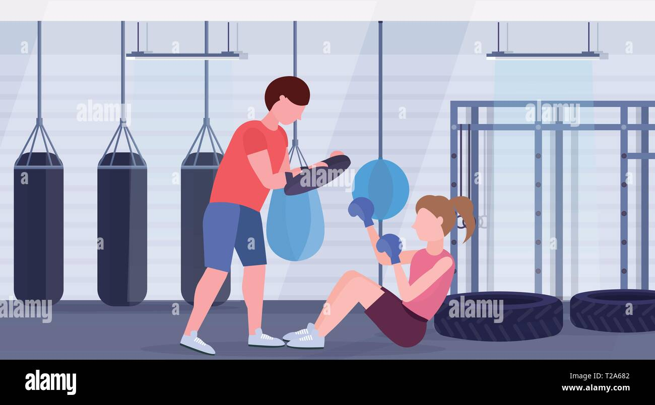 sportswoman boxer doing boxing exercises with personal trainer girl fighter in blue gloves working out on floor fight clubwith punching bags gym - Stock Vector