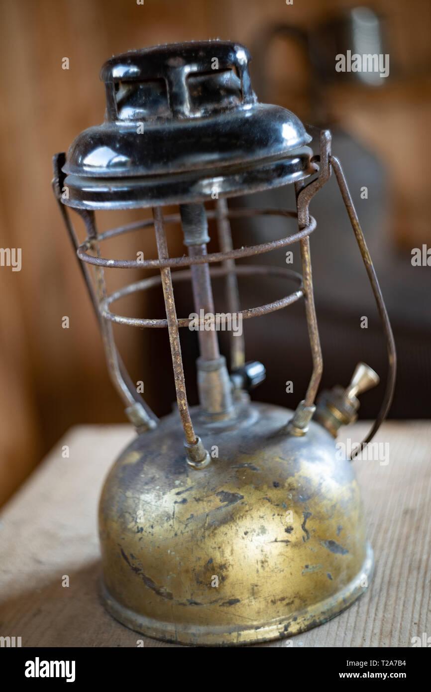 gas lamp in a trapper's hut / cabin - Stock Image