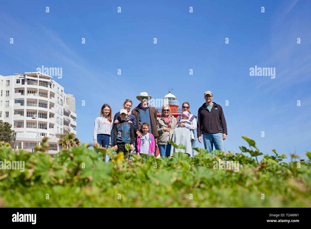 A family and their dog on the promenade, Sea Point, Cape Town. Stock Photo