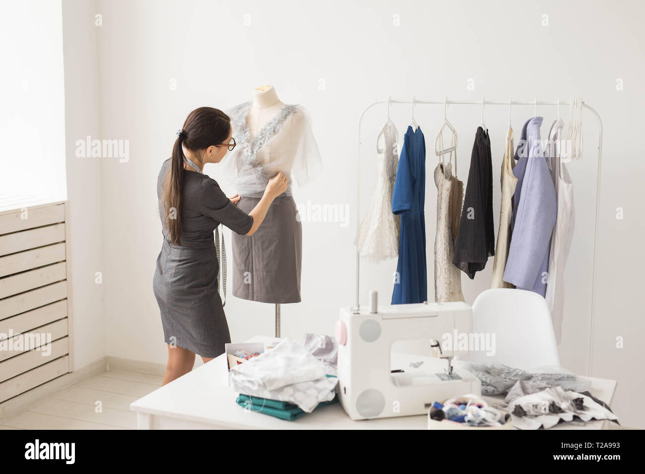 Dressmaker Tailor Fashion And Showroom Concept Side View Of Female Fashion Designer Measuring Materials On Mannequin In Office Stock Photo Alamy