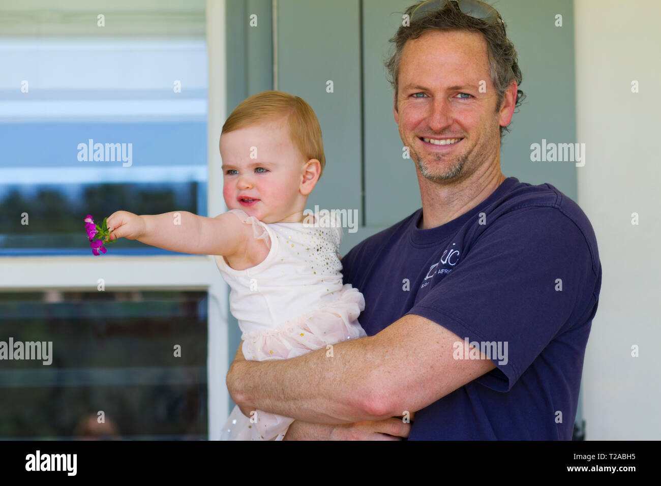 Uncle and niece. Baby girl turns one. Stock Photo