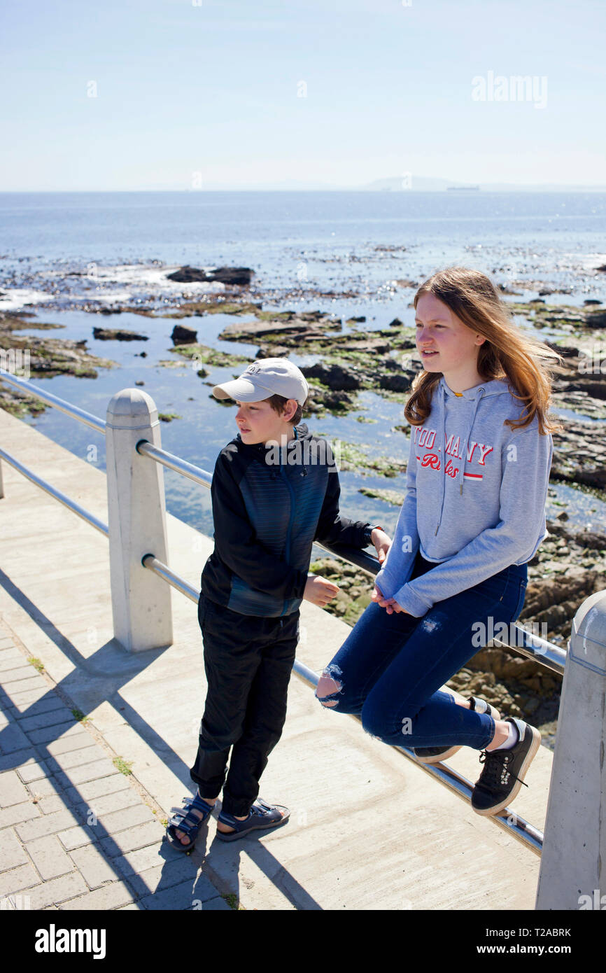 Bother and sister on the Sea Point Promenade. Stock Photo