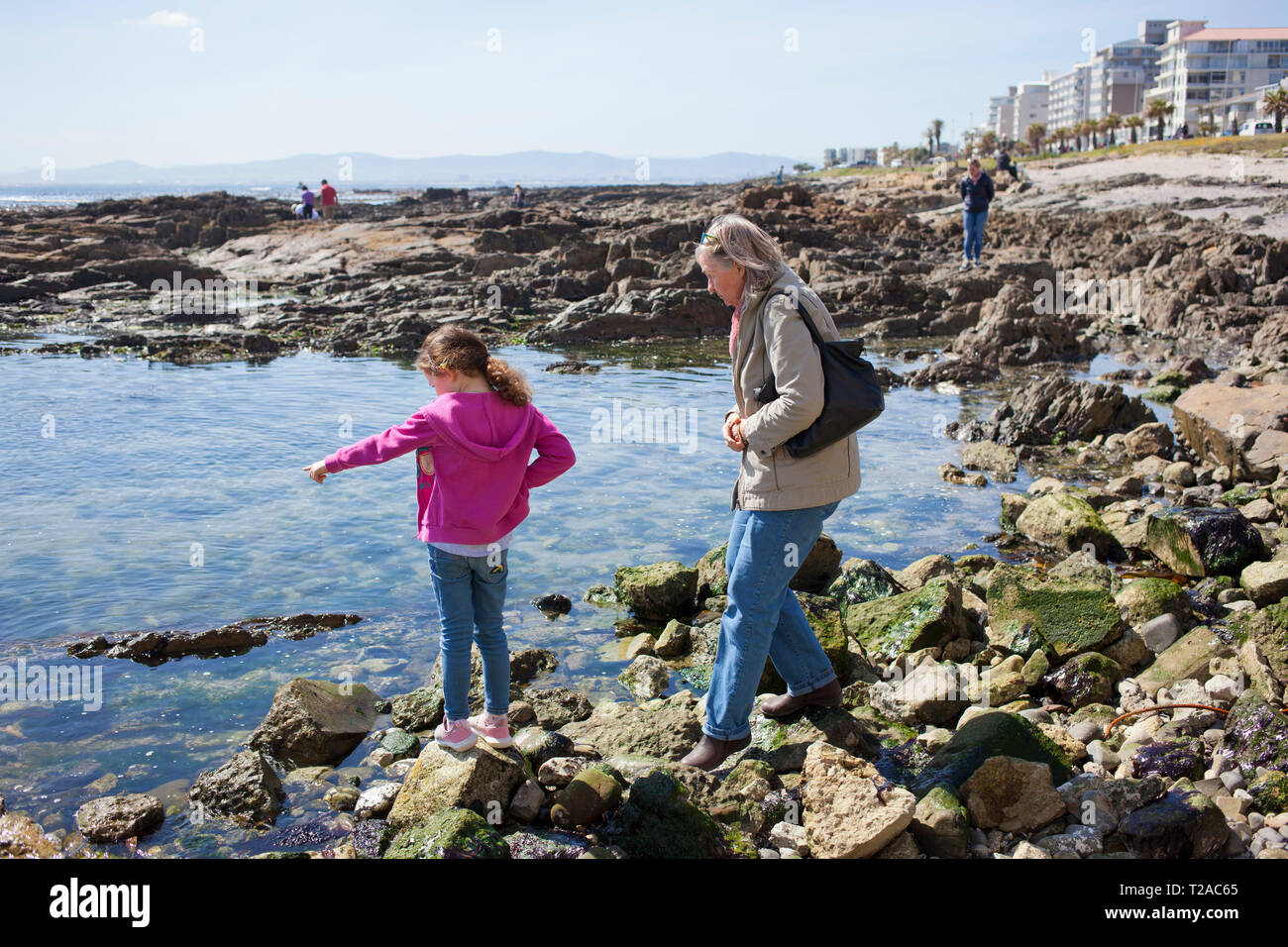 Girl and her grandmother at the sea, Sea Point , South Africa Stock Photo
