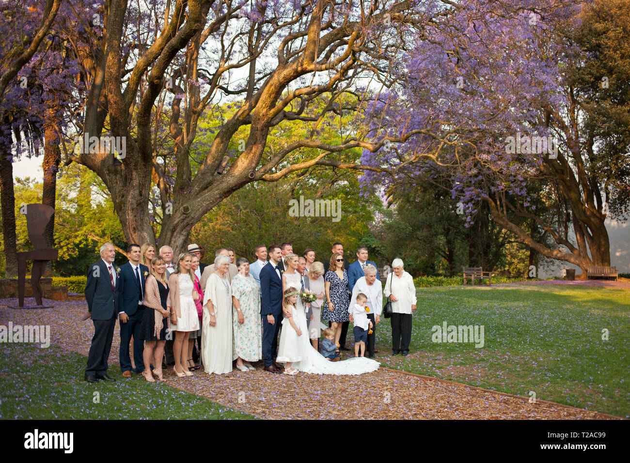 The bride, groom and family at a wedding at St Andrew's School for Girls Stock Photo