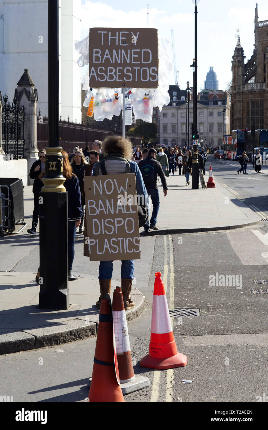 They banned asbestos, ban Disposable plastics, billboard man in London. - Stock Image
