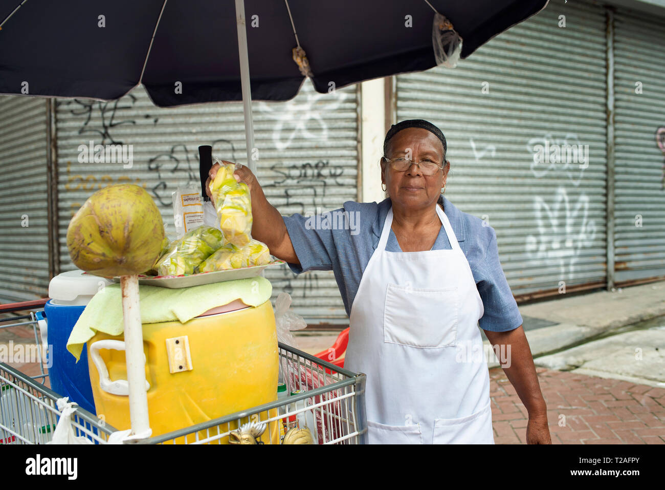Local woman selling fruits on the main shopping street, Avenida Central. Panama City, Panama. Editorial use only. Oct 2018 - Stock Image