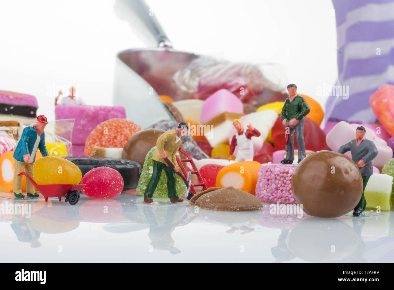 Miniature people - Sweet selection - Stock Image