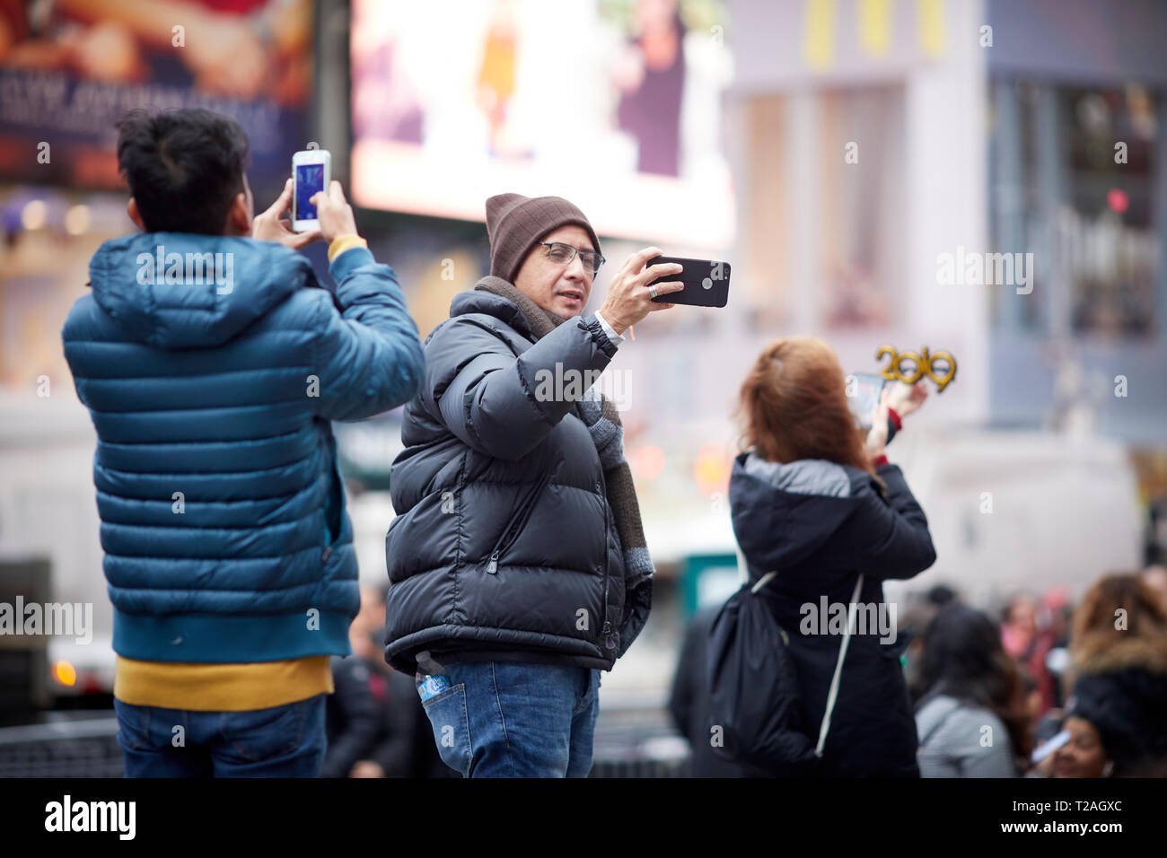 New York Manhattan tourist posing for photos in Times Square USA - Stock Image