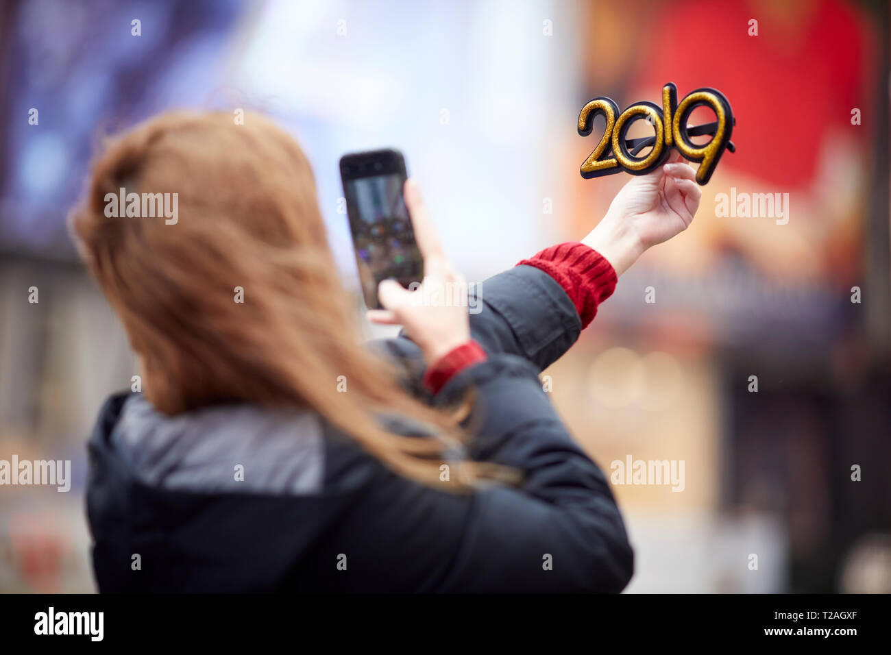 New York Manhattan tourist posing with a 2019 hew year glasses  in Times Square USA Stock Photo
