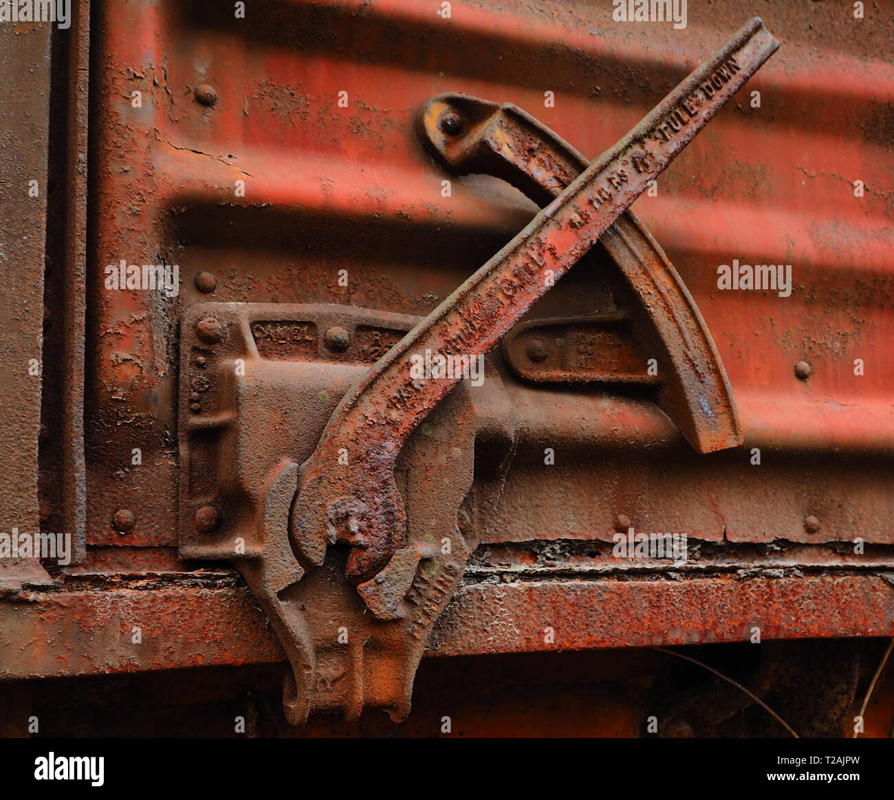 Abandoned railroad train box car locking cam and latch, vintage trail detail close up - Stock Image