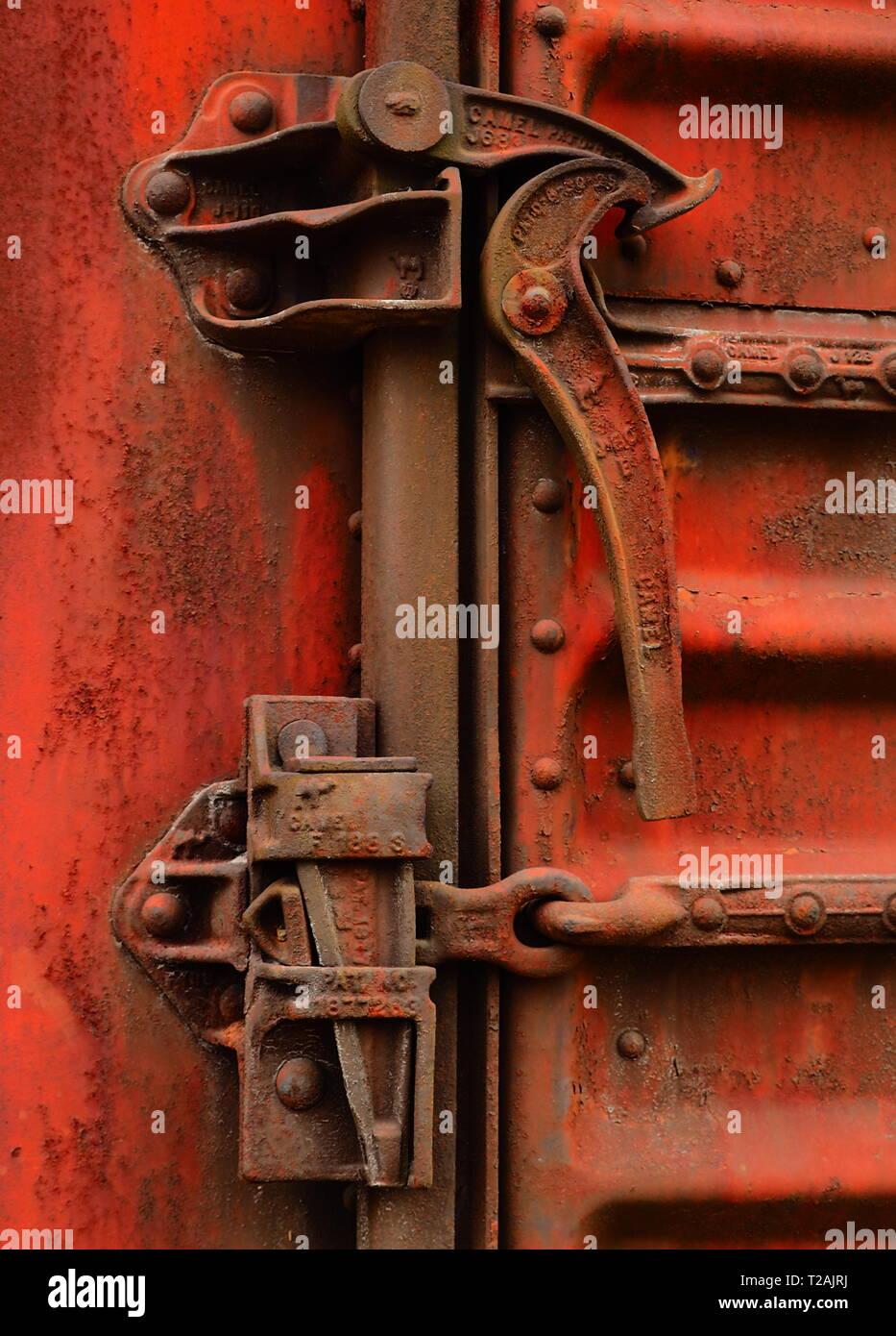 Lock on abandoned railroad hopper car, vintage  train detail - Stock Image