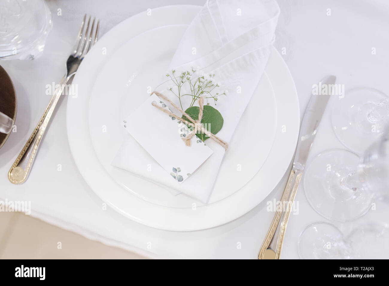 Wedding Place Setting With Napkin On Plate Stock Photo Alamy