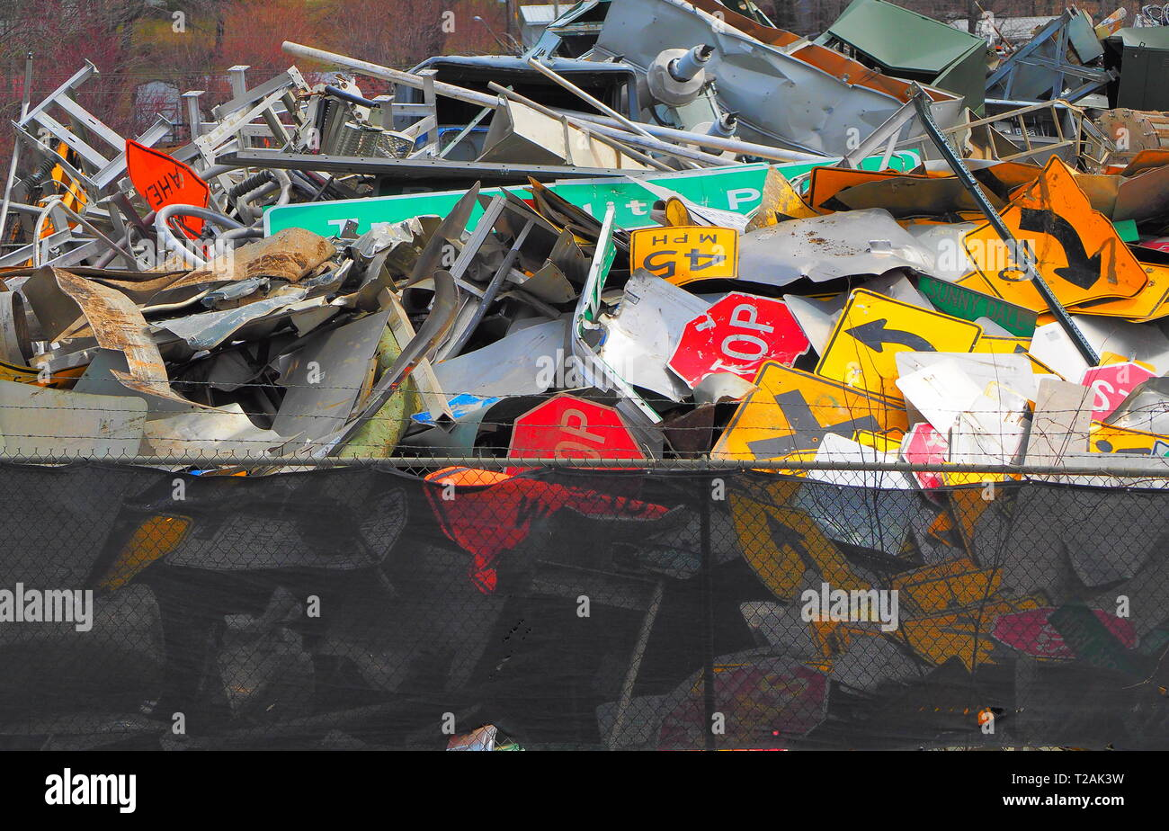 Abandoned road signs in a scrap yard, modern recycling - Stock Image