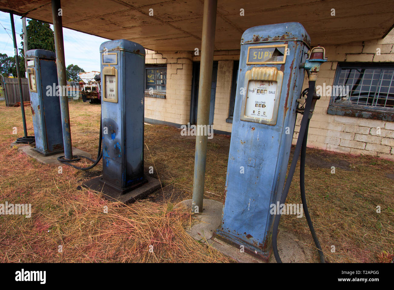 A disused service station with retro petrol pump bowser in