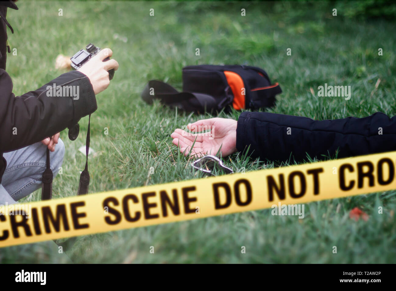 Criminological expert photographing evidence at the crime scene. Law and police concept. Selective focus - Stock Image