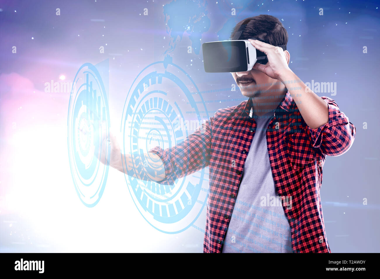 6431d8523192 Asian man touching a circle on digital interface with virtual reality  device display the world map