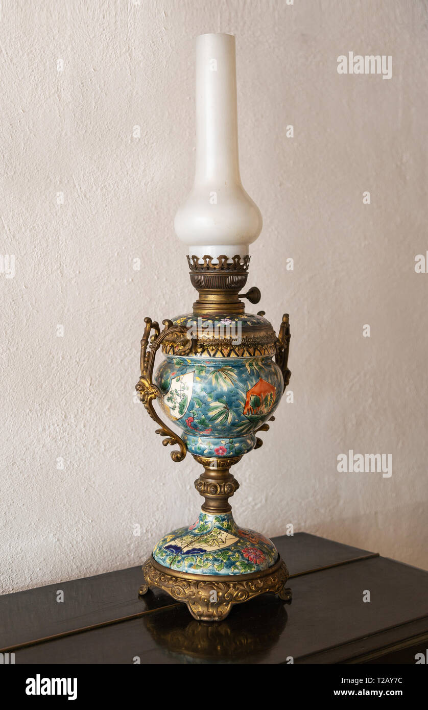 Old Ceramic Oil Lamp On Table Stock Photo Alamy