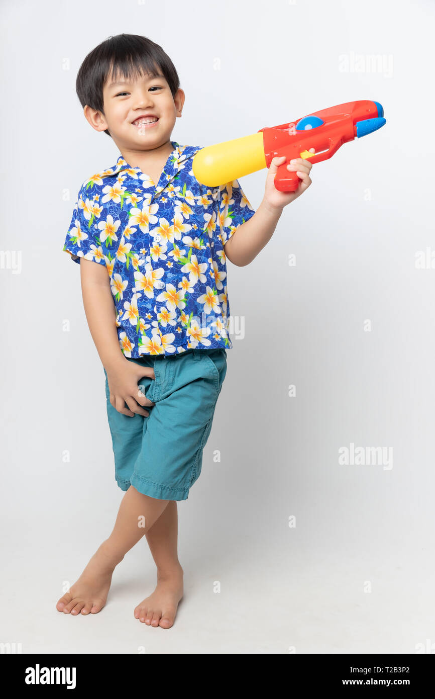 920843b77 Welcome Thailand Songkran festival, Portrait of Asian boy wearing flower  shirt smiled with water gun on white background.