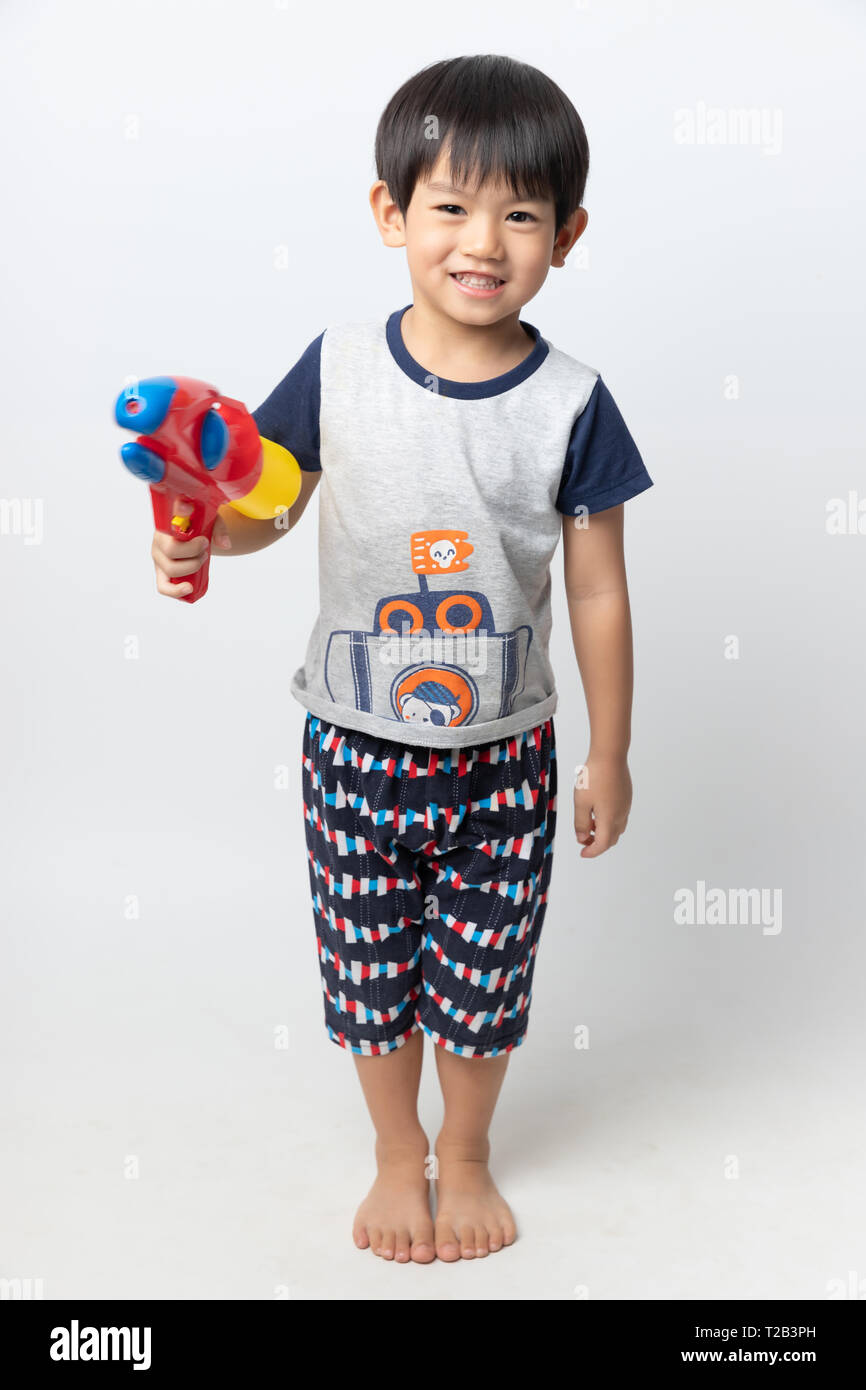 e2dd54c88 Welcome Thailand Songkran festival, Portrait of Asian boy smiled with water  gun on white background.