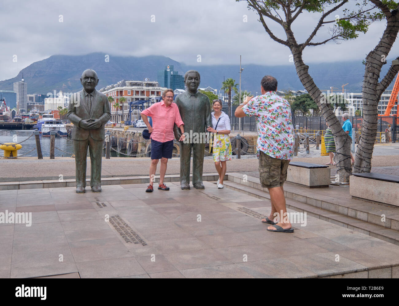 Tourists posing for picture next to Nelson Mandela statue, Nobel Square, Victoria & Alfred waterfront, Cape Town, South Africa, Stock Photo