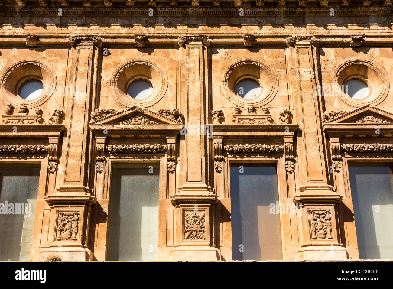 The facade of a building in the city of Granada, Spain, showing a architectual influence by the Moors. - Stock Image
