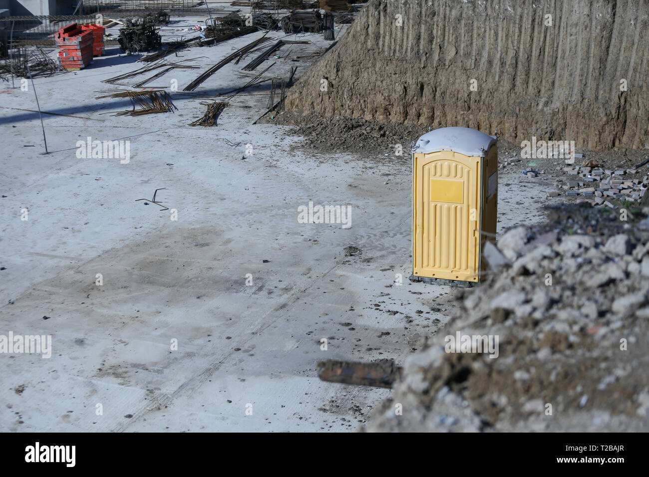 Public toilet cabin on a construction site - Stock Image