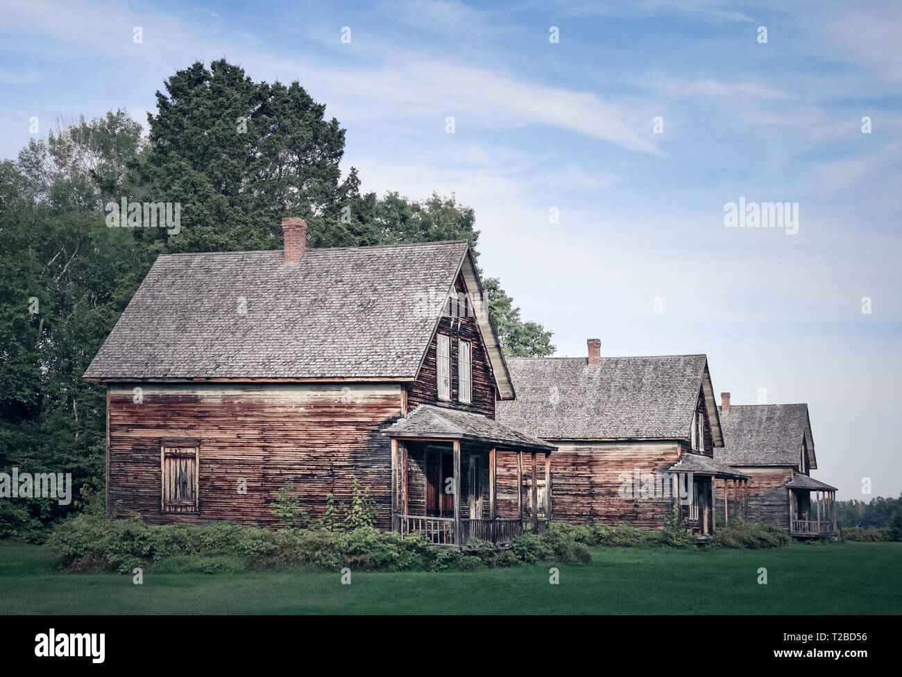 Abandoned village with wooden country houses from old times. - Stock Image