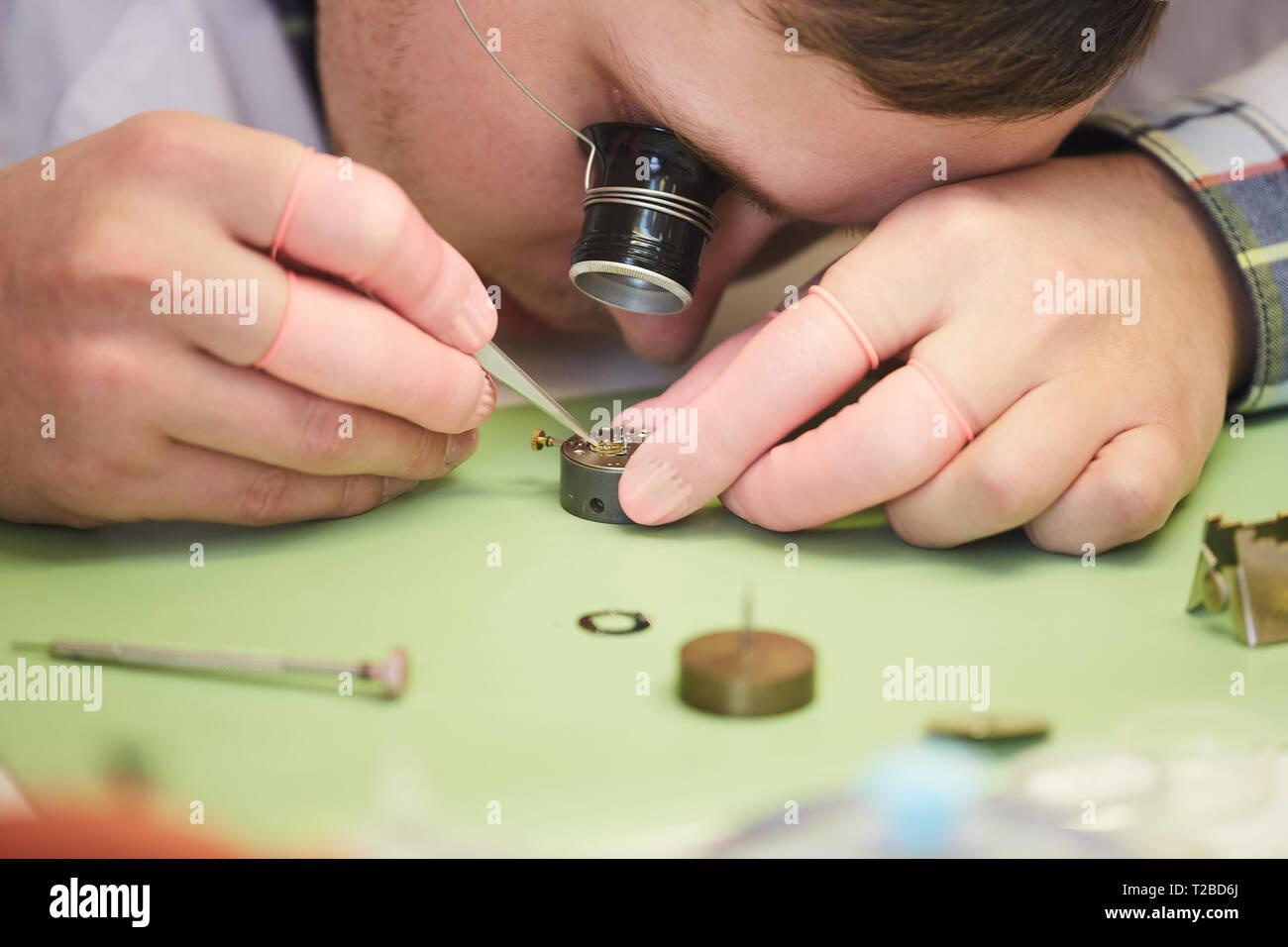Clockmaker Fixing Watch - Stock Image